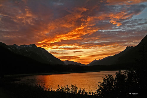 Sunset Muncho Lake by Albert Rollins